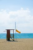 Lifeguard Station. A lifeguard station flying the yellow flag on a Spanish beach stock photo