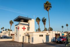 Lifeguard station against a blue sky with palm trees stock photos