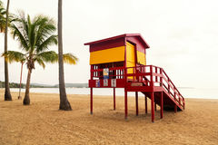 Lifeguard station. Classic lifeguard station on empty tropical beach on cloudy day in low season royalty free stock photography