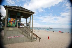 Lifeguard Station in Front of Pier Stock Image
