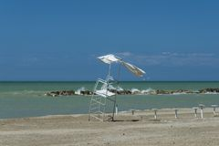 Lifeguard station inclined by strong wind. Lifeguard station in strong wind stock images