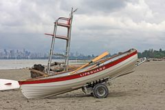 Lifeguard station on Jericho Beach. Lifeguard Paddle board and dinghy, on Jericho Beach, Vancouver stock image