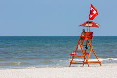 Lifeguard Station. A lone life guard scans the water for danger on a Florida beach royalty free stock image