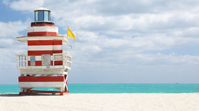 Lifeguard station in Miami Beach. Lifeguard station with a lighthouse shape and painted in red & white stripes. Miami Beach royalty free stock photography