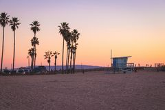 Lifeguard station and palm trees in Venice Beach, California. stock photography