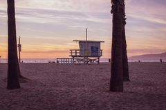 Lifeguard Station between palm trees in Venice Beach, California. stock photo