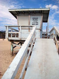 Lifeguard station on a sunny beach. A lifeguard station is shown on a sunny American beach Stock Images