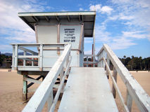 Lifeguard station on a sunny beach. A lifeguard station is shown on a sunny American beach Royalty Free Stock Photo