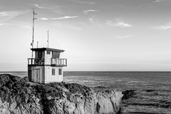 Lifeguard Station at Sunset in Southern California in Black and. Lifeguard Station at Sunset  in black and white at Leo Carillo State Beach in Southern Royalty Free Stock Photo