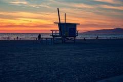 Lifeguard station Venice Beach, California. Lifeguard station at sunset Venice Beach, California. People enjoying a colorful sunset royalty free stock photos