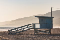 Lifeguard Station on Zuma Beach in Malibu, California. A lifeguard station with a foggy background and mountains on Zuma Beach in Malibu, California stock images