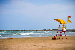 Lifeguard and stormy sea Stock Photography