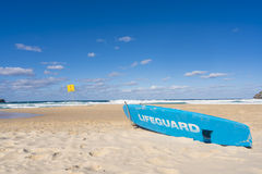 Lifeguard surfboard on beach Royalty Free Stock Photography
