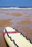 Rescue surfboard on the beach Royalty Free Stock Photography