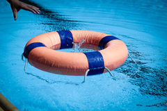 Lifeguard throw Life ring floating to someone in swiming pool Stock Photography