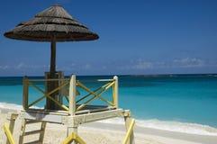 Lifeguard  tower. Lifeguard tower and parasol on idyllic tropical beach Stock Image