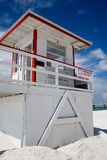 Lifeguard Tower. With sign displaying lifeguard on duty on white sandy beach with brilliant blue sky Stock Images