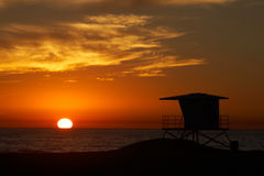 Lifeguard tower. With setting sun on the horizon Stock Image