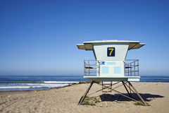 Lifeguard tower 7 against pretty blue morning sky with sea behind it. Seen on Pacific Ocean beach near Ventura, California during the early morning hours before stock photography