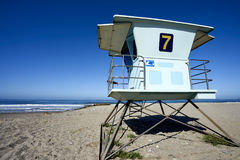Lifeguard tower 7 against pretty blue morning sky with sea behind it. The lifeguard was already duty when arrived during my early morning walk on the sandy beach royalty free stock image
