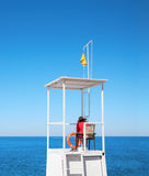 Lifeguard on tower. On the background of sky and sea Stock Images
