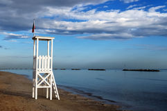 Lifeguard tower on the beach. A lifeguard tower on deserted beach in early morning Stock Photography