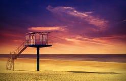 Lifeguard tower on a beach at sunset. Lifeguard tower on a beach at sunset, saturated colors stock image