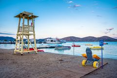 Lifeguard tower with beach wheel chair for disabled swimmers, Elounda, Crete. Greece stock photography
