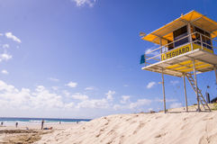 Lifeguard Tower on Beach. Yellow lifeguard tower watching over beach with blue sky at Snapper Rocks, Surfers Paradise, Queensland, Australia Royalty Free Stock Image