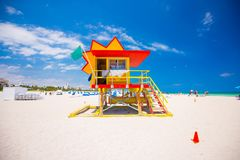 Lifeguard tower in a colorful Art Deco style, with blue sky and Atlantic Ocean in the background. World famous travel location. So stock photo
