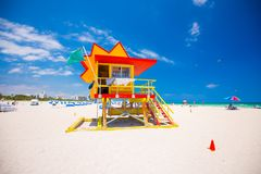 Lifeguard tower in a colorful Art Deco style, with blue sky and Atlantic Ocean in the background. World famous travel location. So stock images