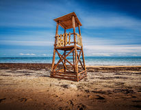 LIFEGUARD TOWER - CRETE - INTRALEX 2016. LIFEGUARD TOWER ON THE CRETAN BEACH WITH BLUE CLOUDY SKY AS BACKROUND Royalty Free Stock Photography