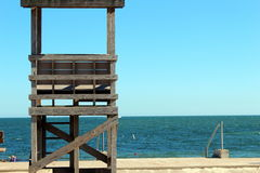 Lifeguard tower. Empty lifeguard tower with a blue sea and sky background Royalty Free Stock Photo