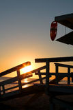 Lifeguard tower in front of a romantic sunset in santa monica beach Stock Image