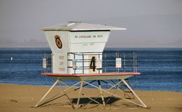 Lifeguard Tower in Late Afternoon on Beach in Santa Cruz, California. Colorful, late afternoon view of the lifeguard tower, sand and ocean in Santa Cruz royalty free stock photos