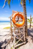 Lifeguard tower with a lifeline of palm trees on Royalty Free Stock Image