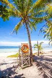 Lifeguard tower with a lifeline of palm trees on Stock Image