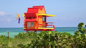 Lifeguard tower in Miami. Miami Beach in South Beach with new lifeguard tower and coastline with colorful cloud and blue sky. Florida. USA stock video