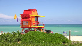 Lifeguard tower in Miami. Miami Beach in South Beach with new lifeguard tower and coastline with colorful cloud and blue sky. Florida. USA stock video footage