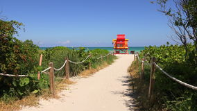 Lifeguard tower in Miami. Miami Beach in South Beach with new lifeguard tower and coastline with colorful cloud and blue sky. Florida. USA stock footage