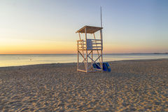 Lifeguard Tower On The Beach At Sunrise Stock Photo