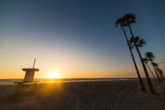 Lifeguard tower and palm trees in Newport beach Royalty Free Stock Image