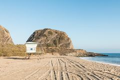 Lifeguard Tower at Point Mugu State Park with Mugu Rock on PCH. A lifeguard tower at Point Mugu State Park on the Pacific Coast Highway in Malibu, California Royalty Free Stock Images