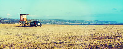 Lifeguard tower and police truck in Newport Beach Royalty Free Stock Photo