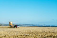 Lifeguard tower and police truck in Newport Beach Royalty Free Stock Photos