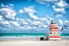 Lifeguard tower for rescue baywatch on beach in Miami, USA. Lifeguard tower for rescue baywatch on south beach in Miami, USA. Red and white wooden house on sea Royalty Free Stock Images