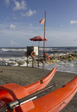 Lifeguard tower and rowing boat on the shoreline. MARINA DI MASSA, ITALY - AUGUST 17 2015: Lifeguard tower and rowing boat on the shoreline with rough seas Stock Photos