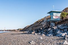 Lifeguard Tower on South Carlsbad State Beach with Power Plant Tower Stock Photo