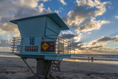 Lifeguard tower at sunset stock photos