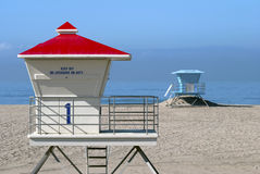 Lifeguard Towers. A pair of unoccupied lifeguard towers at the beach on a sunny day Stock Photography